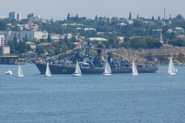 Sailing regatta and the navy ship